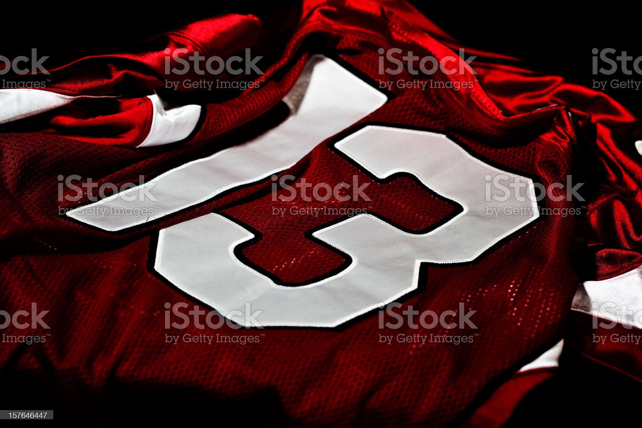 Dark red and white jersey with the number thirteen on it royalty-free stock photo