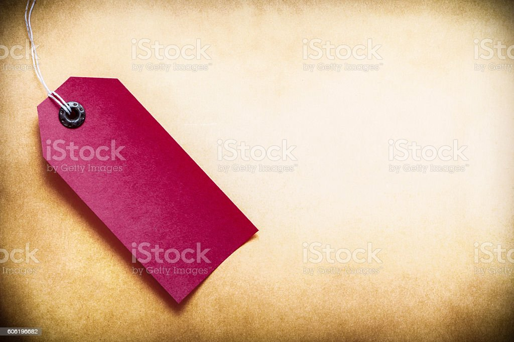 dark red  lable on paper background stock photo