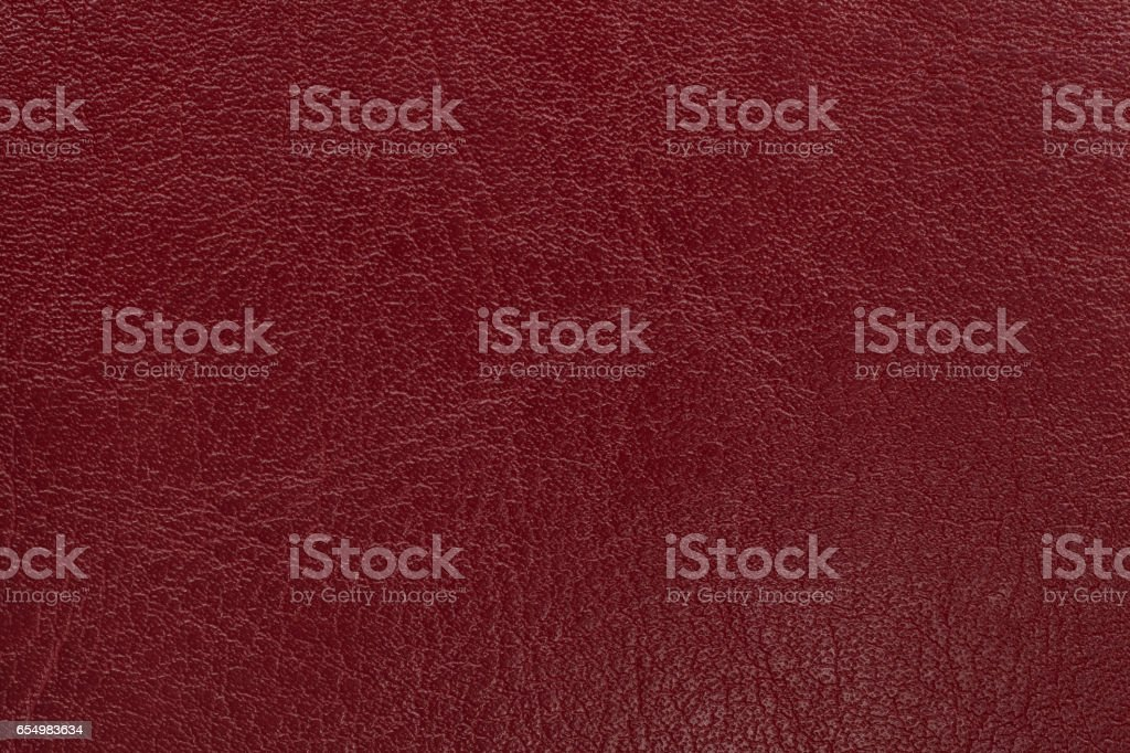 Dark red leather texture background. Closeup photo. stock photo