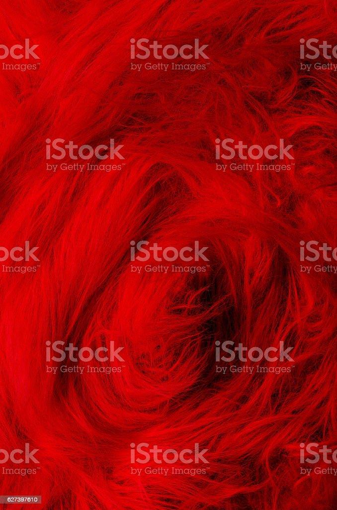 Dark red plush fabric swirl stock photo