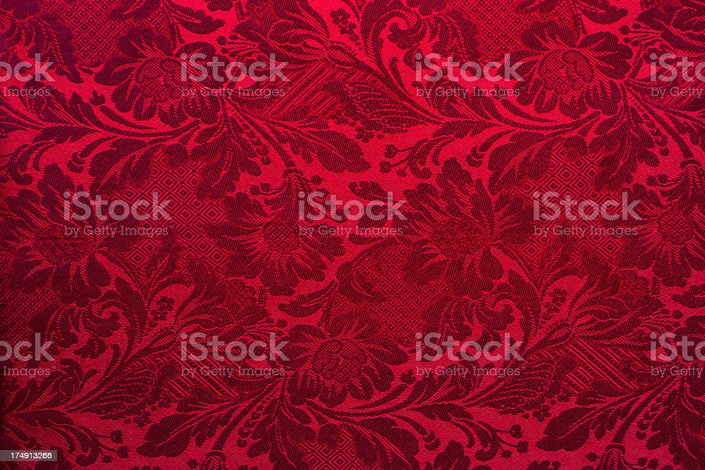Dark red textile wallpaper on the wall stock photo