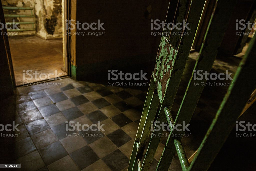 Dark room of an old abandoned prison royalty-free stock photo