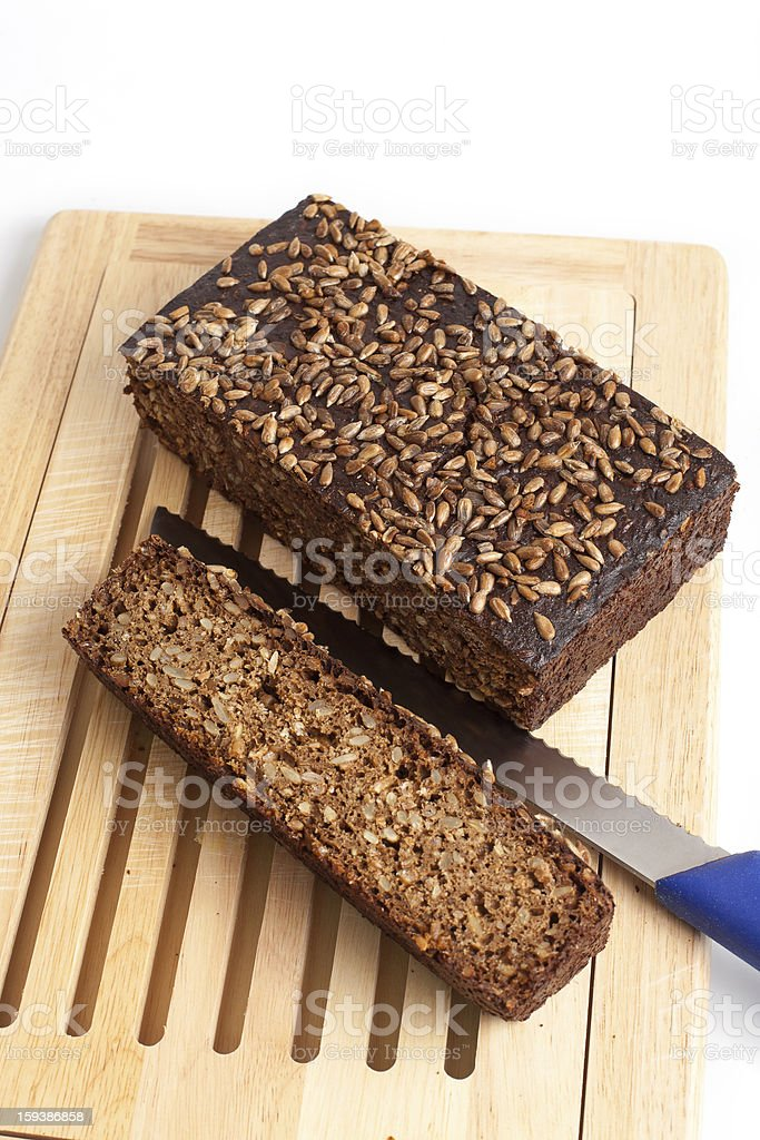 dark rye bread whith knife on a board royalty-free stock photo