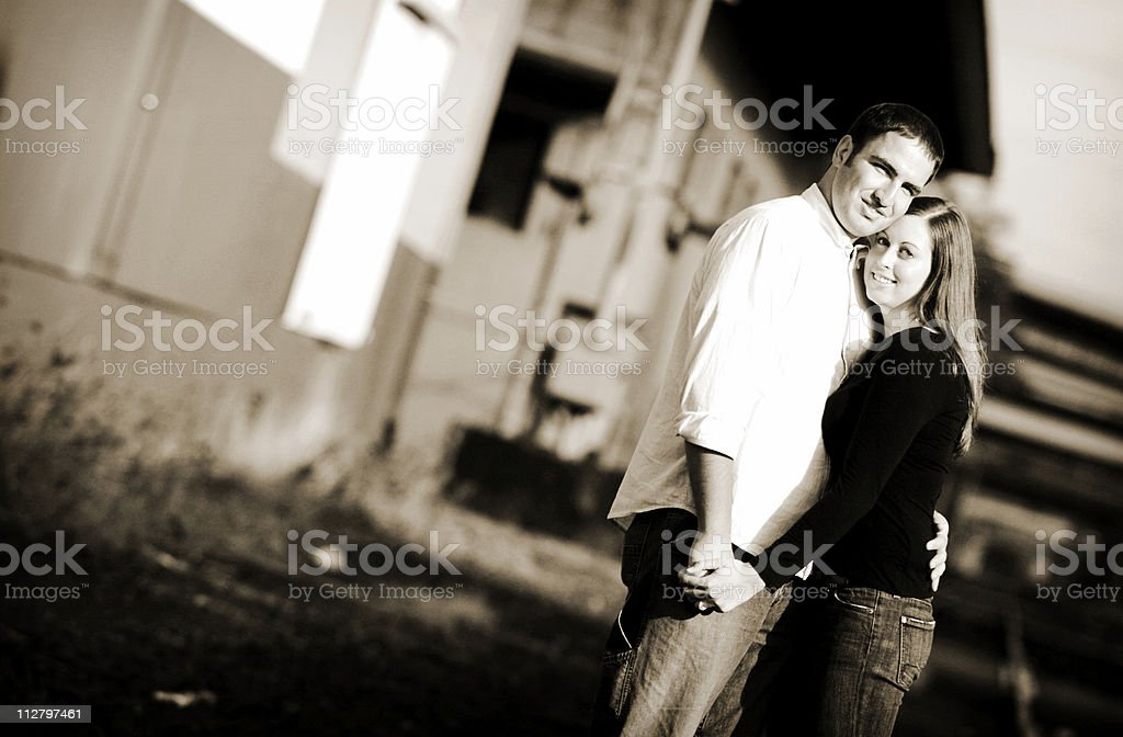 Dark Sepia Toned Portrait of cute Young Loving Couple royalty-free stock photo