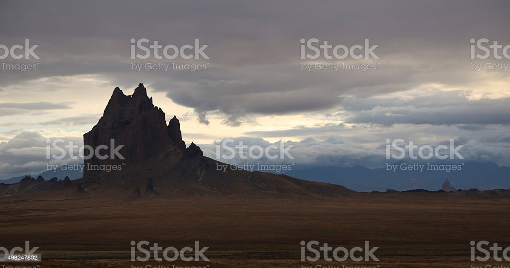Dark silhouette of Shiprock stock photo