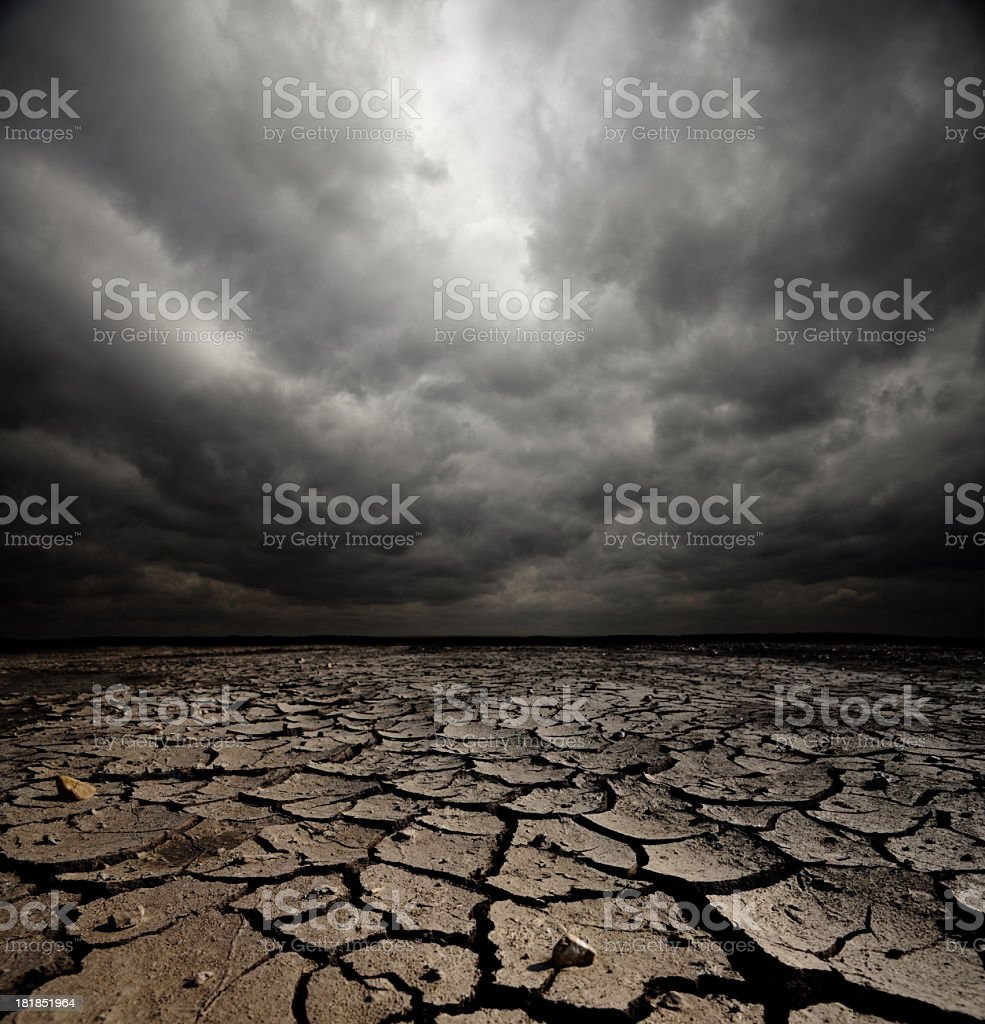 Dark skies lying over broken gravel stock photo