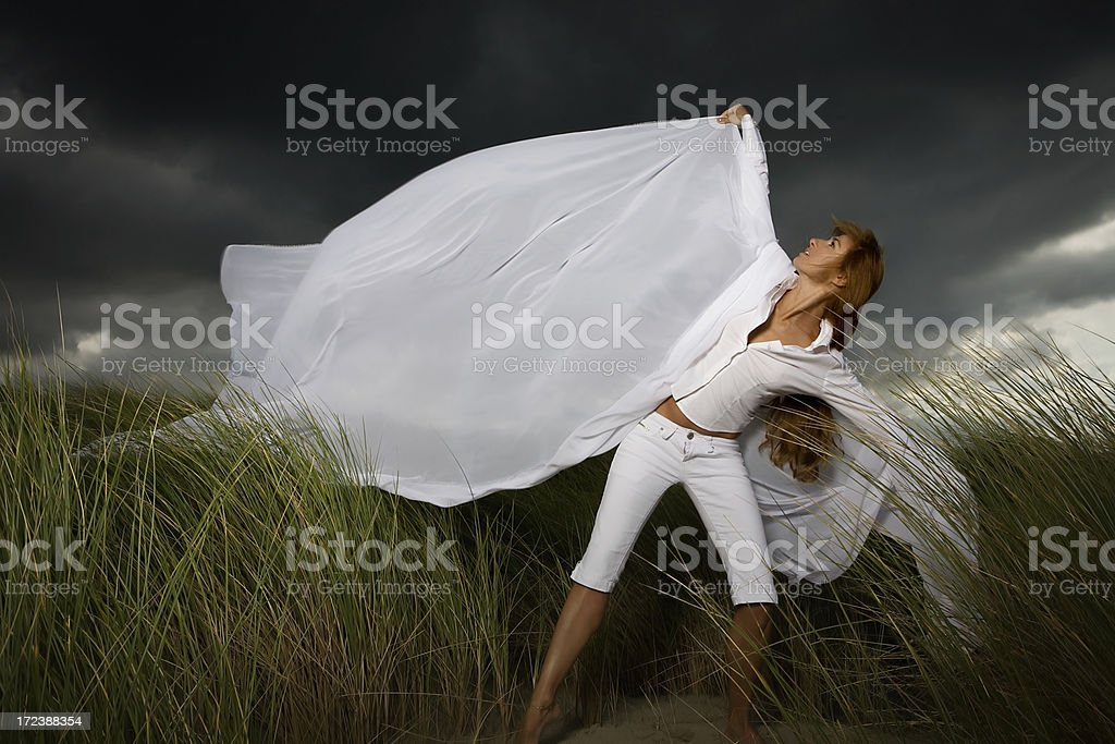dark sky, wind and woman in white stock photo
