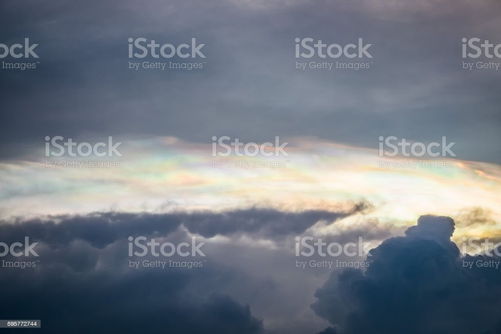Dark sky with iridescent cloud before raining. stock photo
