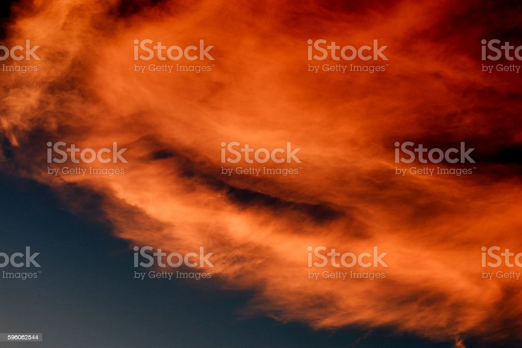 Dark sky with orange clouds at sunset time stock photo