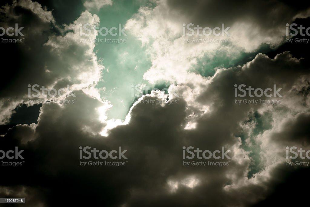 Dark sky with sun burst ray with cloudy stock photo