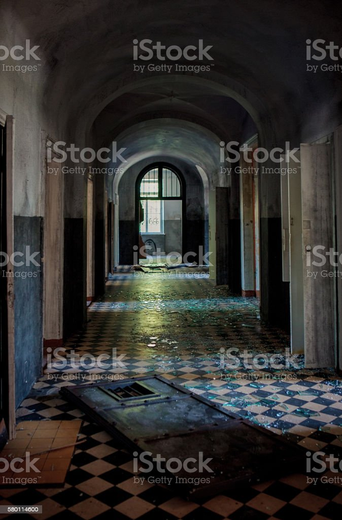 Dark spooky corridor in an old abandoned hospital building stock photo