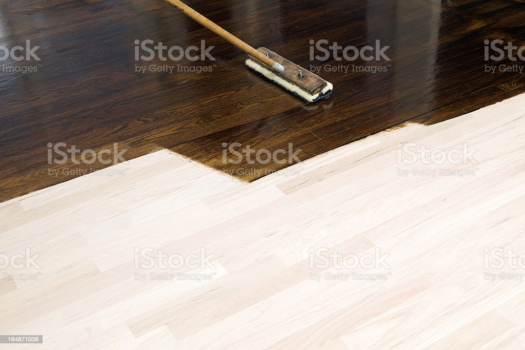 Dark Stain Application on New Oak Hardwood Floor stock photo