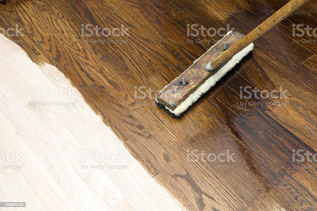 Dark Stain Application on New Oak Hardwood Floor royalty-free stock photo