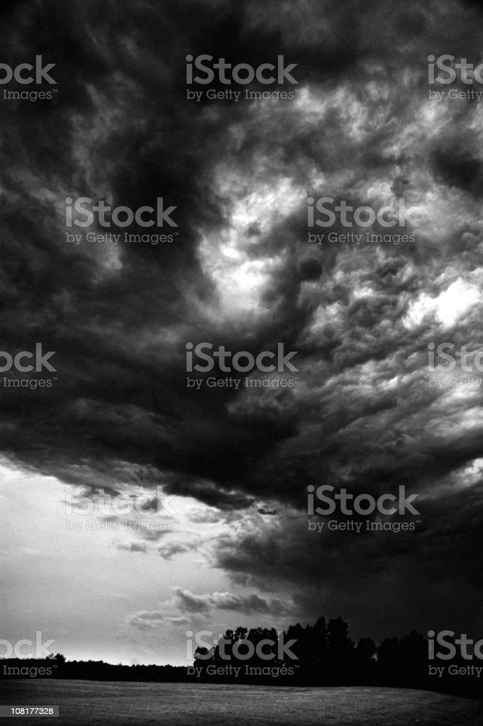 Dark Storm Clouds Above Field, Black and White stock photo