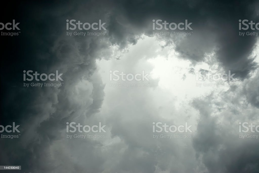 Dark storm clouds gathering in sky royalty-free stock photo