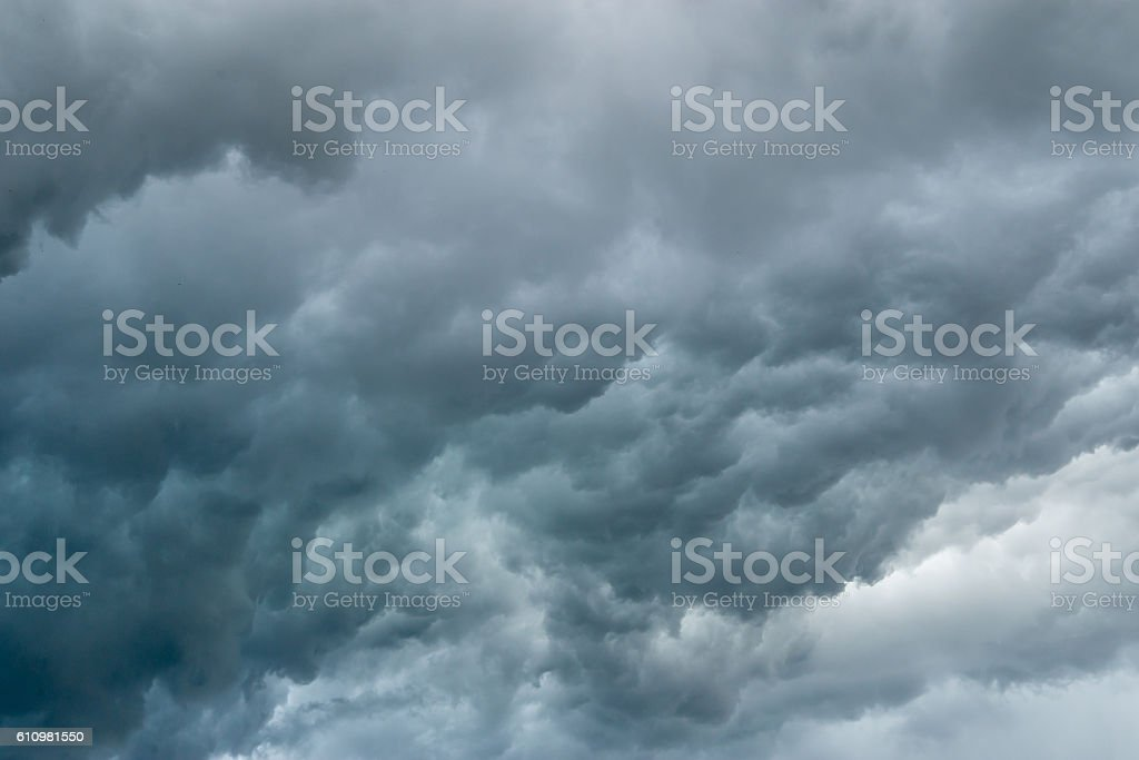 Dark, stormy blue clouds stock photo
