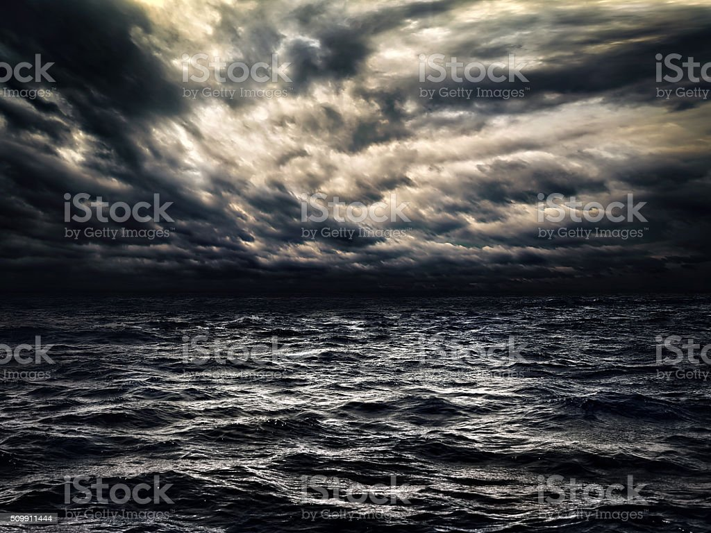 dark stormy sea with a dramatic cloudy sky stock photo