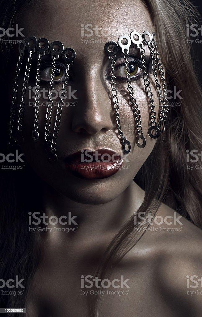 Dark studio beauty portrait with chains royalty-free stock photo