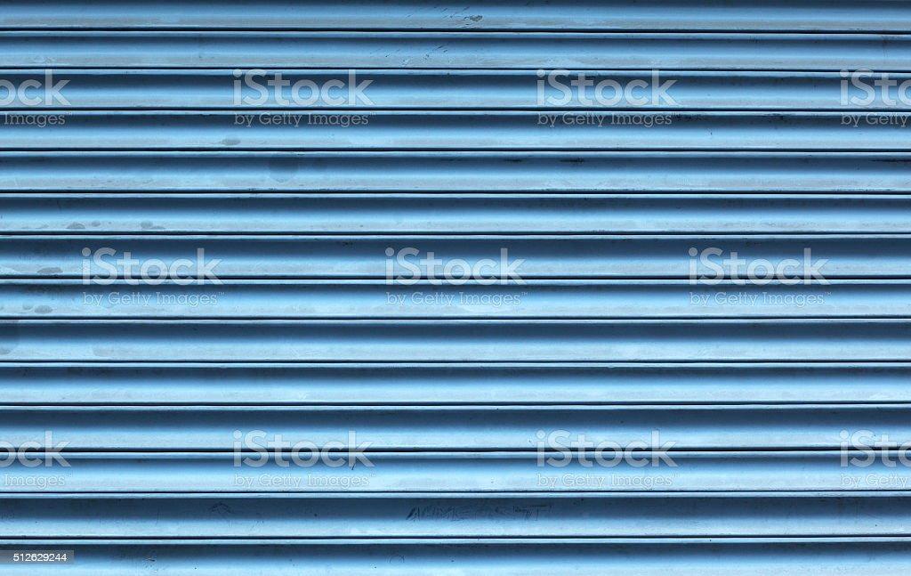 Dark teal painted steel door background stock photo