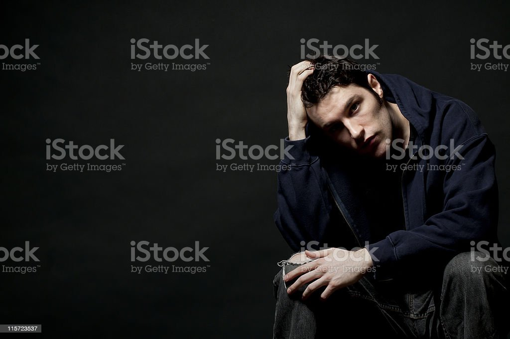 Dark Thoughts, Depressed Serious Teenager in Black Clothing stock photo