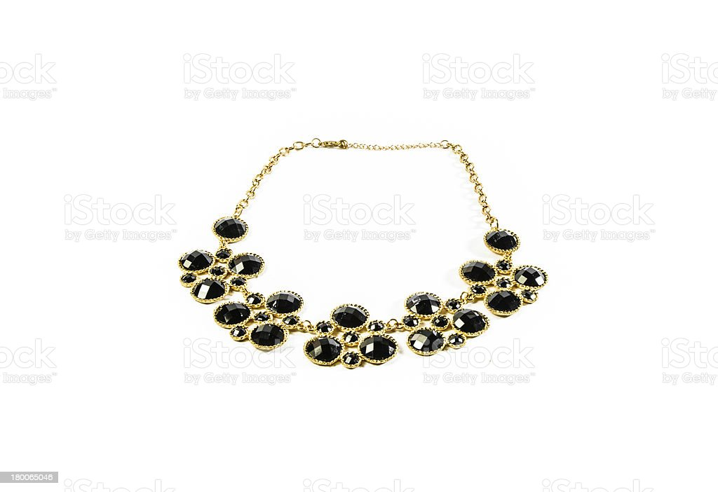 dark tone gem and gold necklace royalty-free stock photo