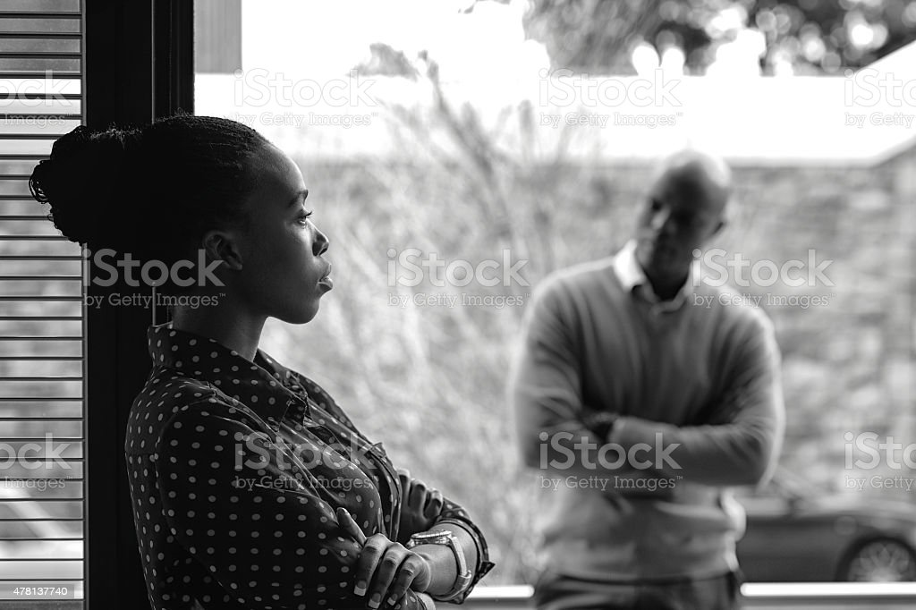 Dark toned image of angry couple not speaking stock photo