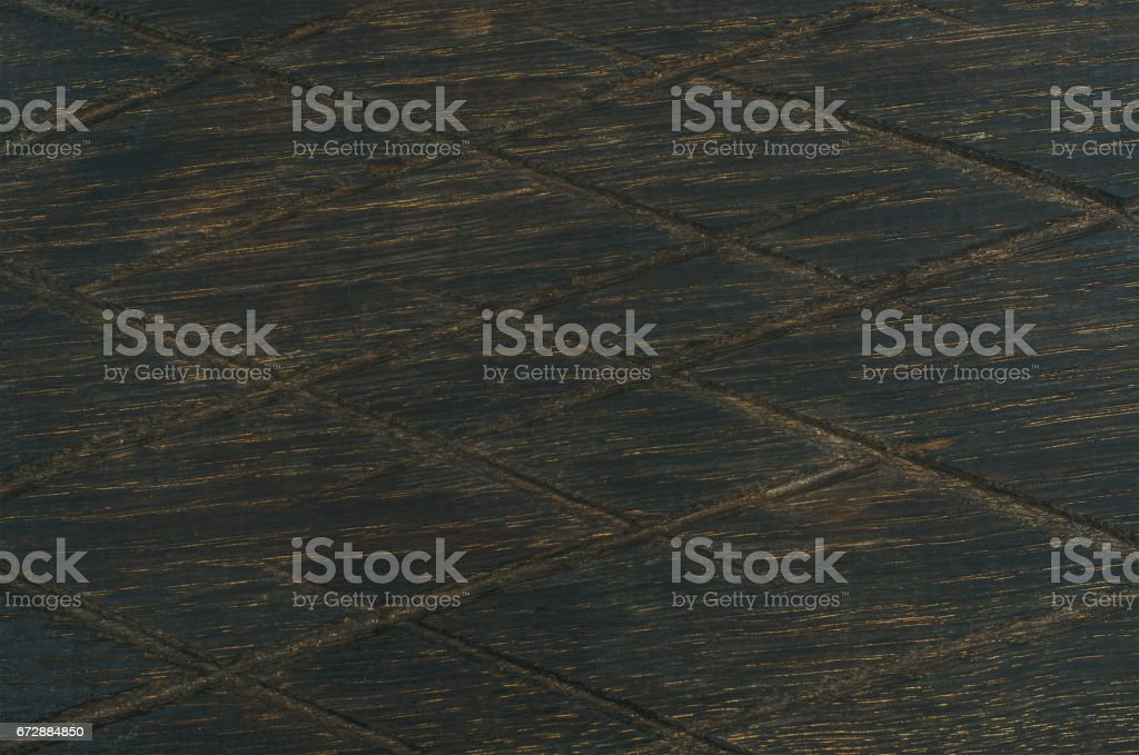 Dark toned natural oak wood texture with notches stock photo