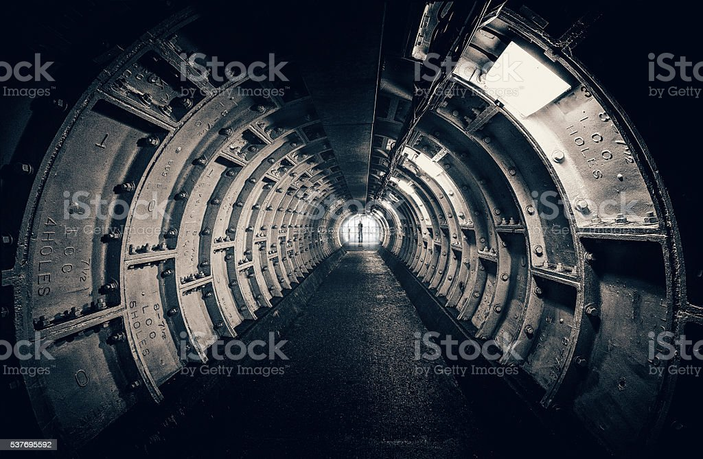 Dark tunnel with interesting structures stock photo