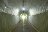 Dark tunnel with light at the exit