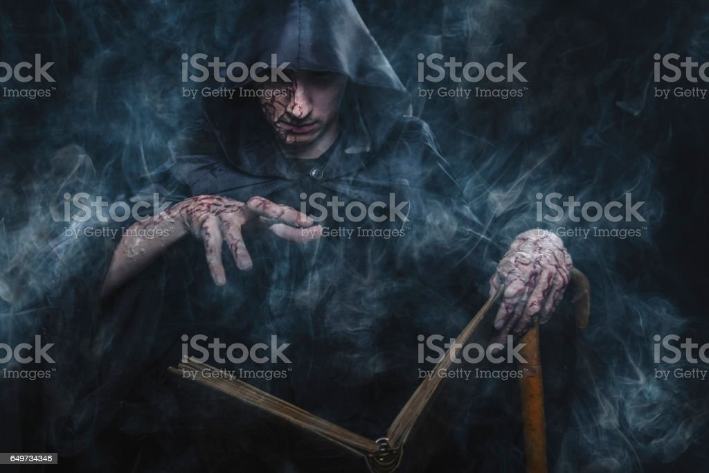 Dark warlock casting spells stock photo