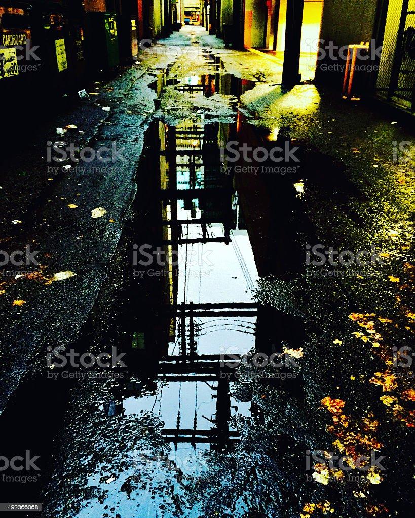 Dark wet city alley at night royalty-free stock photo