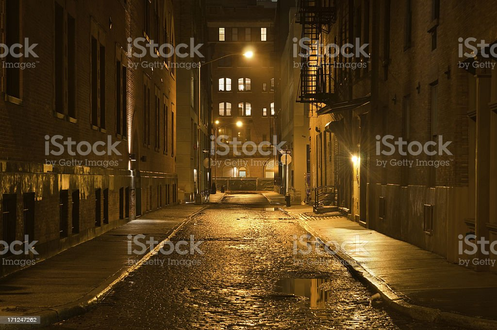 Dark wet street stock photo