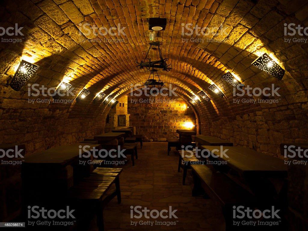 Dark wine cellar with tables stock photo
