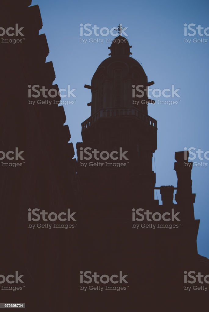Dark winter evening and vintage gothic building. stock photo