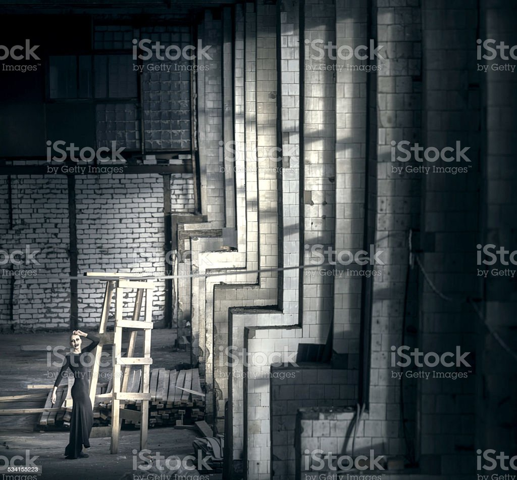 Dark woman in abandoned building stock photo