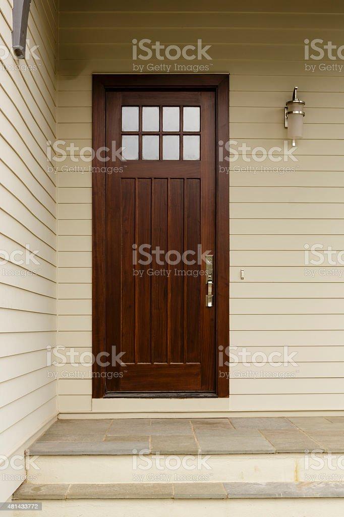 Dark wood skinny front door stock photo