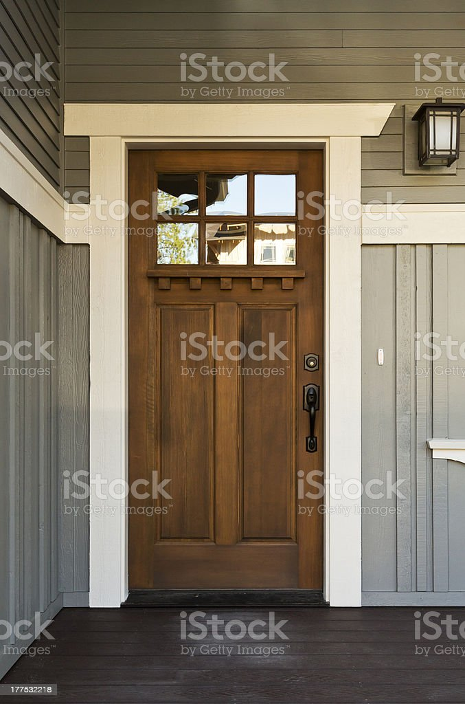 Dark wooden front door from inside a home stock photo