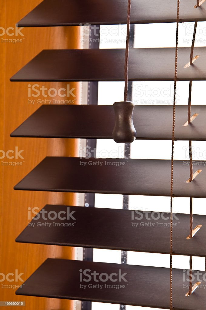 Dark wooden shutterblind close-up stock photo