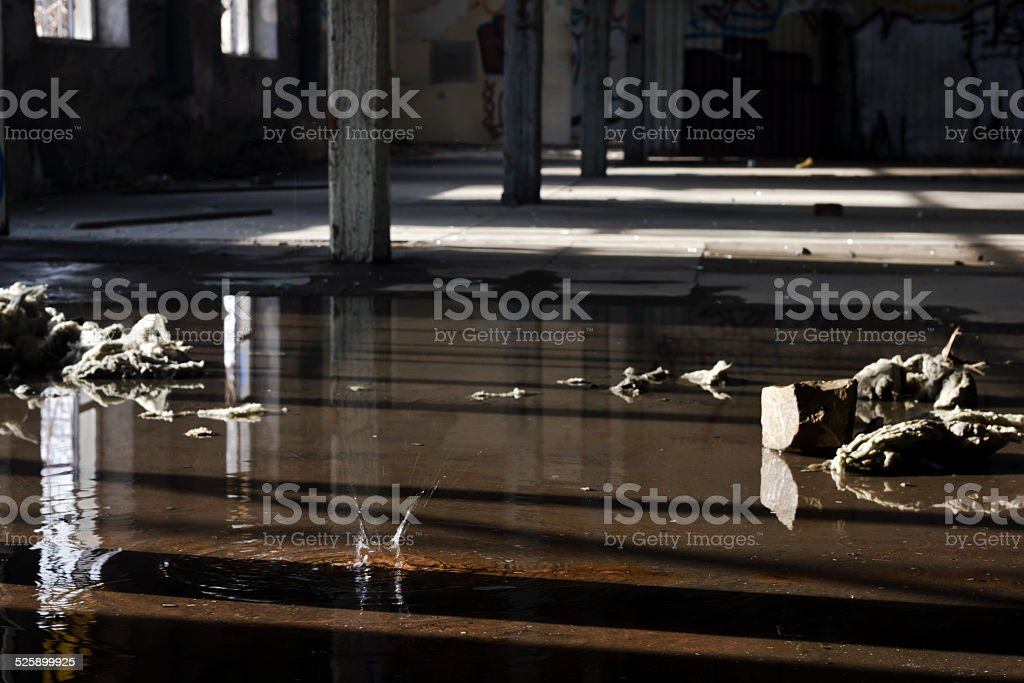 dark,abandoned factory hall due to unemployment stock photo