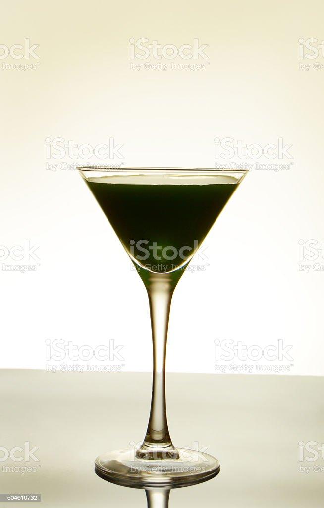 dark-green cocktail on light background stock photo