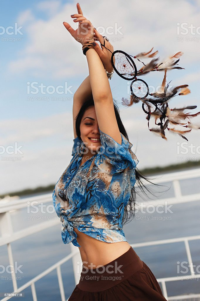 dark-skinned girl with a dream catcher stock photo