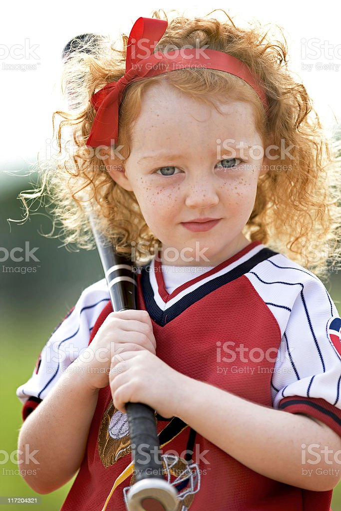 Darling Preschooler Holding A Baseball Bat stock photo