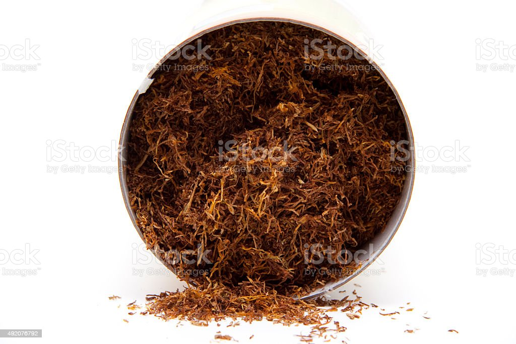 Darning tobacco in can stock photo