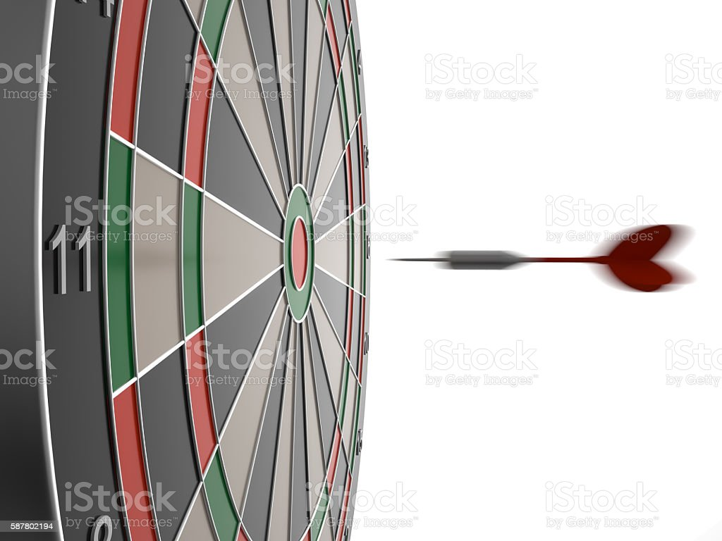 Dart arrow hitting in the target center of dartboard stock photo