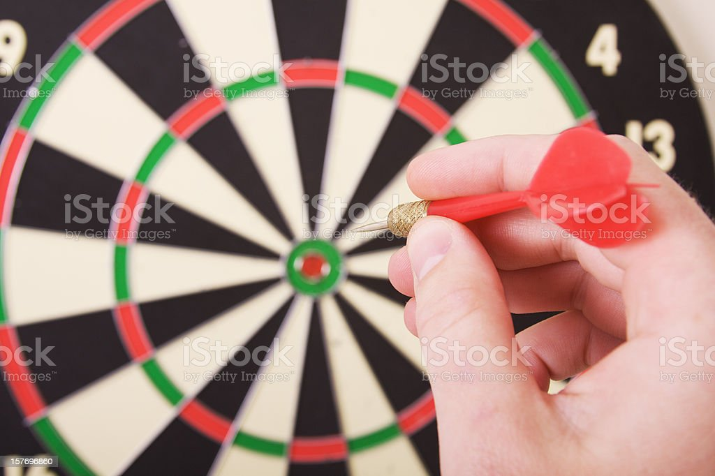 Dart Board and Player royalty-free stock photo