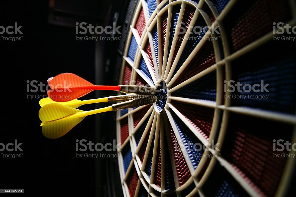 dart board with three darts royalty-free stock photo