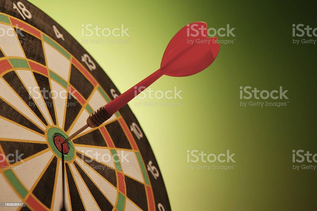 dart in bulls-eye dartboard royalty-free stock photo