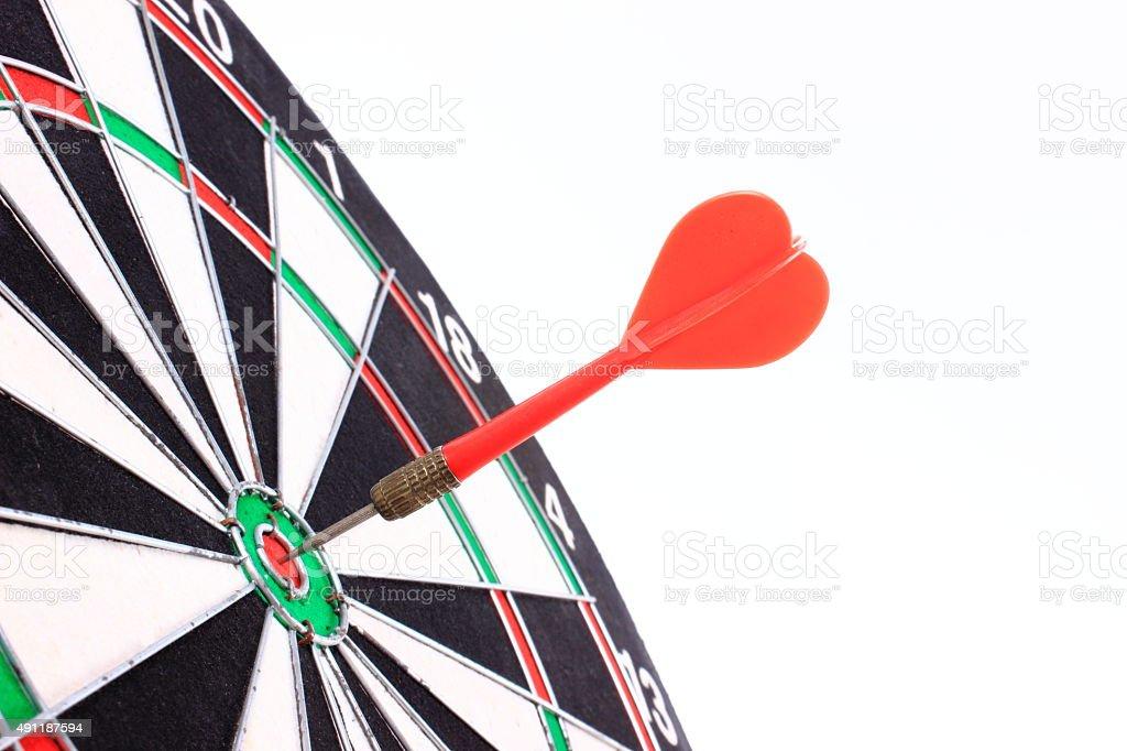 Dart in bull's-eye stock photo