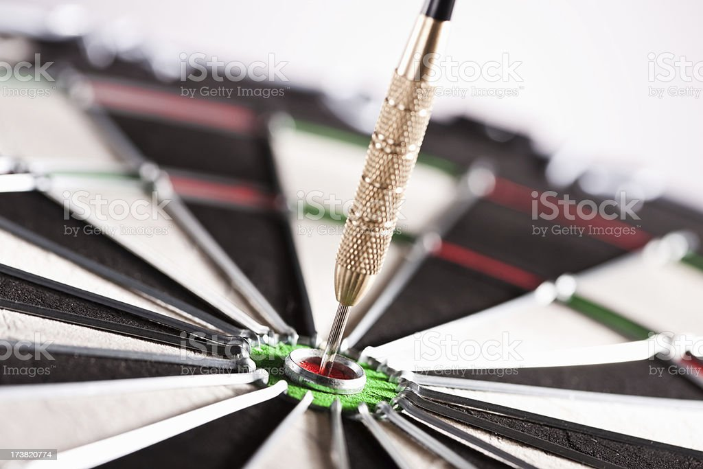 Dart in the center of dartboard royalty-free stock photo
