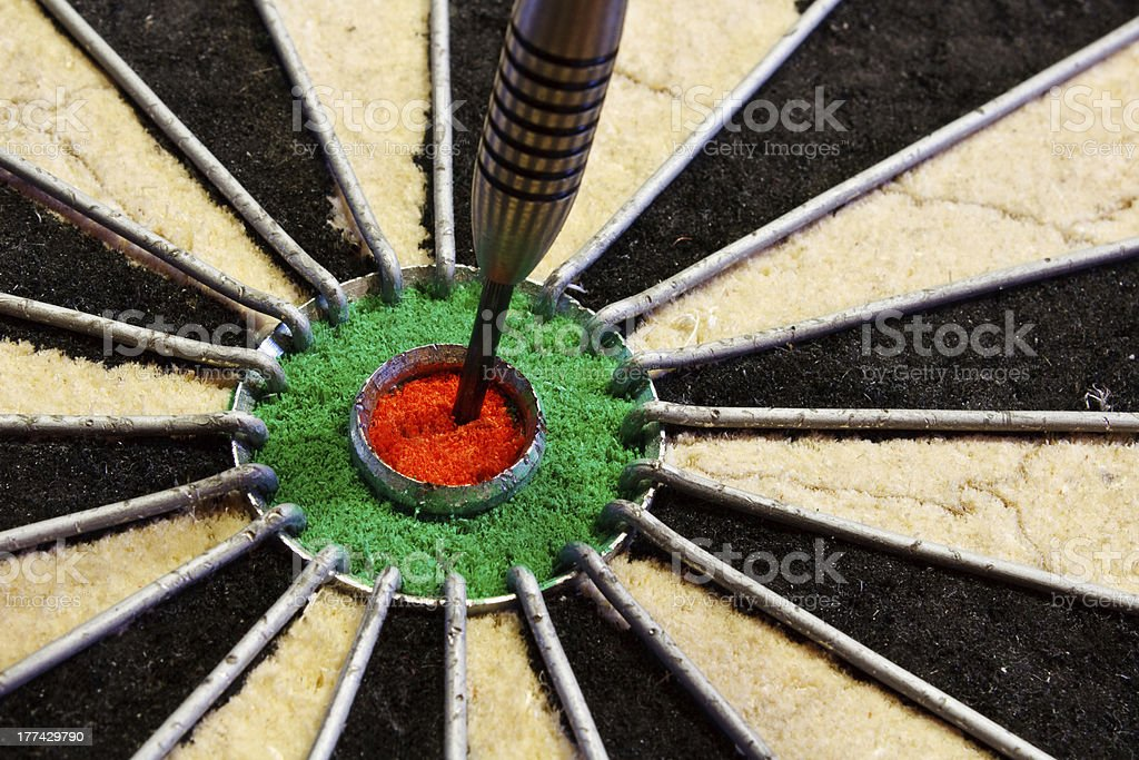 Dart in the centre bulls eye royalty-free stock photo